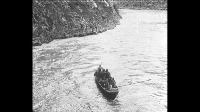 longboat full of wwi russian soldiers moves on river as they retreat from the german army / soldiers disembark from boat at dock and walk up hill /... - defeat stock videos & royalty-free footage