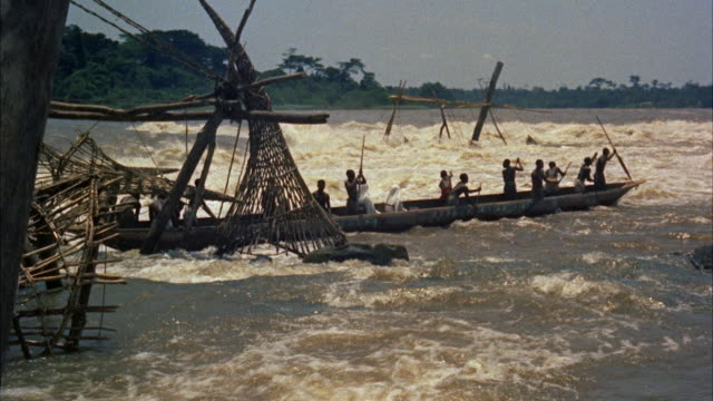 ws pan longboat passing through turbulent river  - viking stock videos and b-roll footage