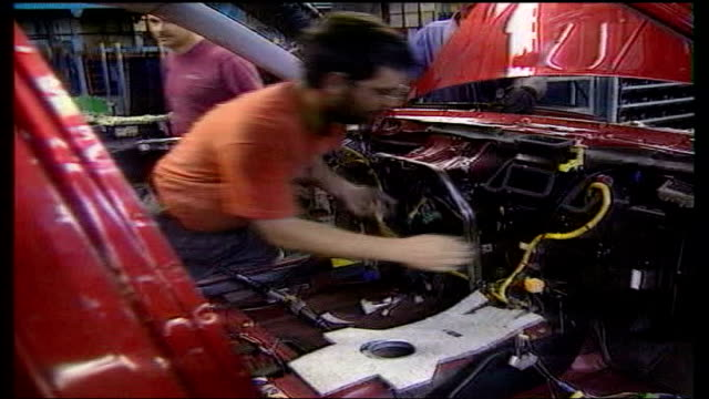 longbridge rover car plant set to restart production; date unknown employees of longbridge factory working on production line - longbridge stock videos & royalty-free footage