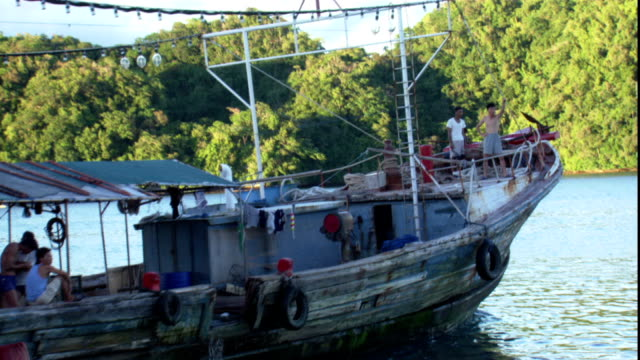 a long-line fishing vessel leaves the docks with crew on board. - pacific islands stock videos & royalty-free footage