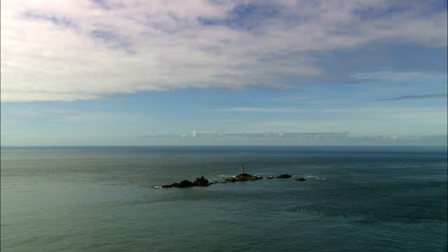 longships lighthouse and land's end  - aerial view - england, cornwall, united kingdom - viking stock videos and b-roll footage