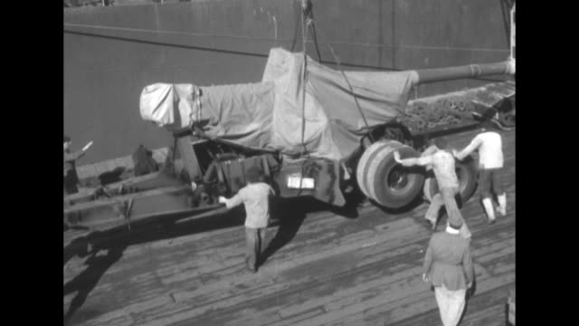 vs longshoremen work with artillery guns after they are offloaded from a us transport ship / vs offloading / guns on dock train / vs gun rises from... - la manche stock videos and b-roll footage