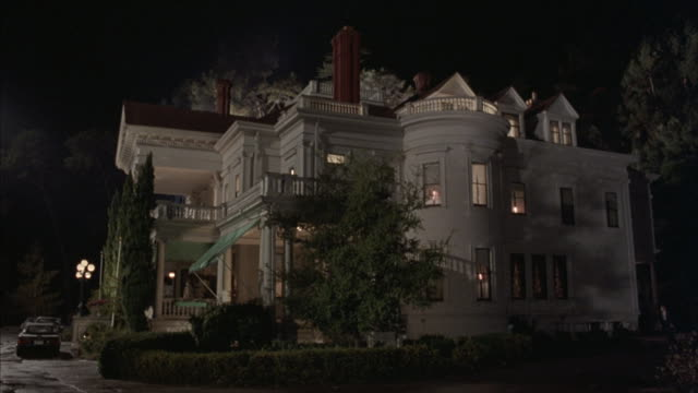 long-shot of a car driving up to a mansion. - front stoop stock videos and b-roll footage