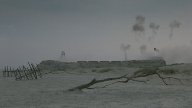 long-shot of a coastal confederate fortress as cannons are fired. - confederate flag stock videos and b-roll footage