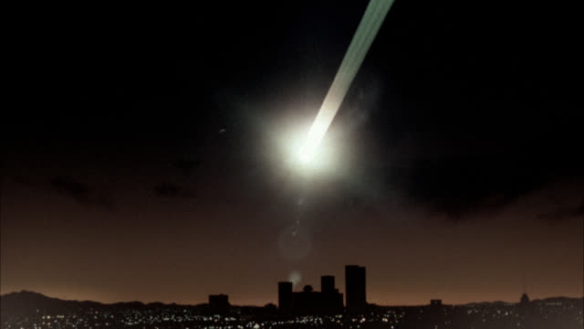 Long-shot of an asteroid falling toward downtown Phoenix at night.