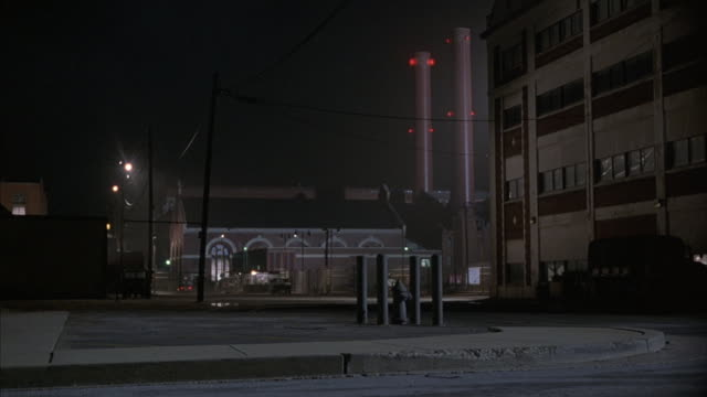 A long-shot of an industrial area at night.