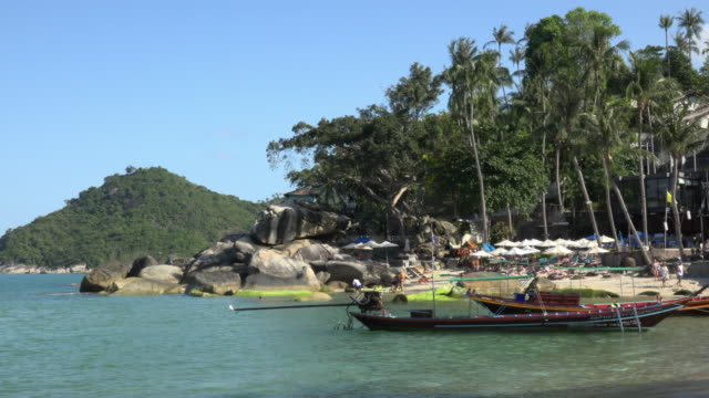 longtail boat at sandy beach with rock formation - gulf of thailand stock videos & royalty-free footage
