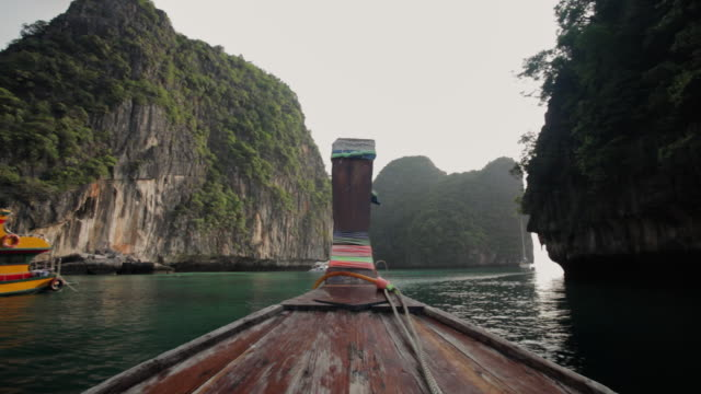 pov a longtail boat motors through a sheltered bay past yachts and boats at koh phi phi leh (or koy phi phi leh) / koh phi phi, thailand - boat point of view stock videos & royalty-free footage