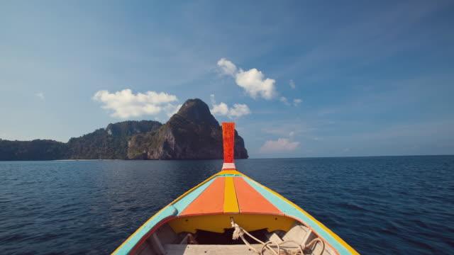 WS T/L POV Longtail boat navigates around Ko Phi Phi Don island to Maya Bay in Ko Phi Phi Leh island / Phi Phi islands, Krabi, Thailand