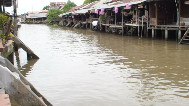 longtail boat river canal amphawa thailand. - longtail boat stock videos & royalty-free footage