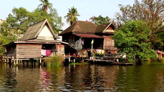 longtail boat river canal bangkok thailand - longtail boat stock videos & royalty-free footage