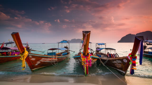 longtail boats in thailand - phi phi islands stock videos & royalty-free footage