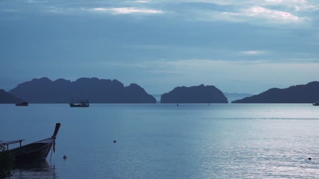 longtail boats on andaman sea before dawn at blue hour - andaman sea stock videos & royalty-free footage