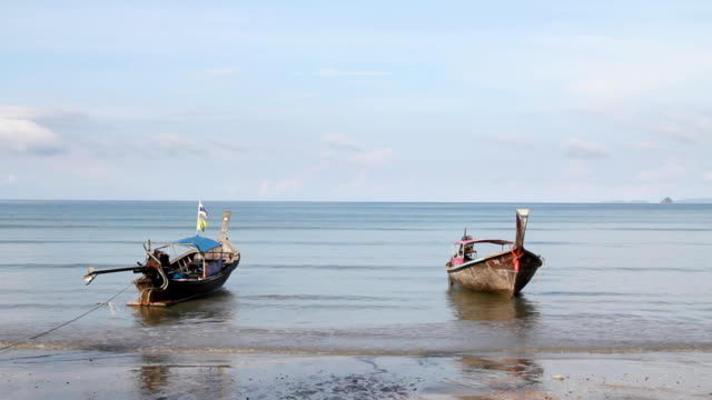 Long-tail boats on the beach.