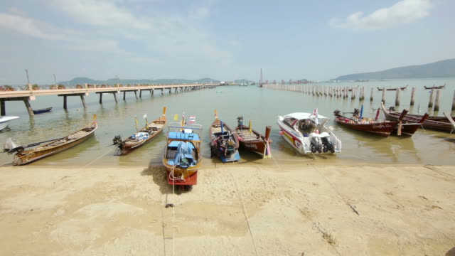 longtailboats in harbour in phuket, thailand. - spoonfilm stock-videos und b-roll-filmmaterial