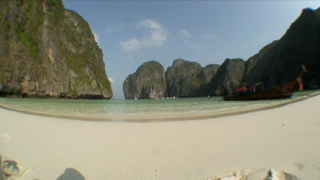 ws long-tailed boat anchored to shore / ko phi phi leh, thailand - anchored stock videos & royalty-free footage