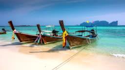 Longtails on a Thai Beach - Thailand