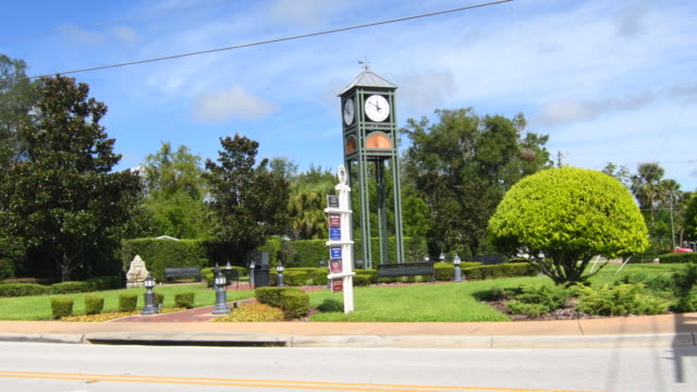 Longwood Florida 1878 clock tower and signage in downtown small town, 4K