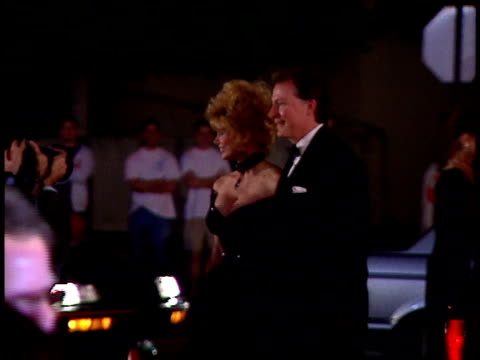loni anderson and date pose for paparazzi on red carpet - loni anderson stock videos & royalty-free footage