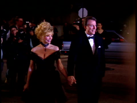 Loni Anderson and date walks down red carpet