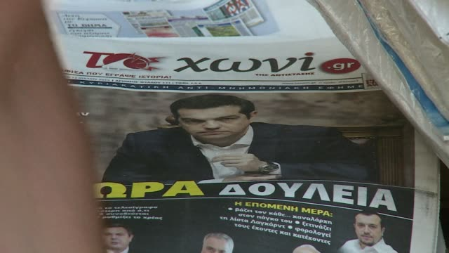 look at newspaper headlines in greece on the day of crunch bailout talks which could determine the country's future - grecia stato video stock e b–roll