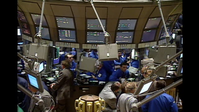 look at the traders on the floor of the new york stock exchange. - trader stock videos & royalty-free footage