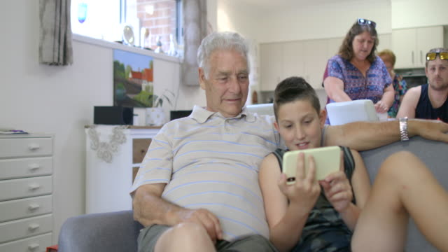 look at this grandad - wireless technology stock videos & royalty-free footage