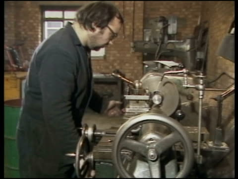 vídeos de stock e filmes b-roll de look at two enterprise boards; england: london: airlec factory chris ross in his factory talking to the workers pull back av man operating lathe used... - 50 seconds or greater