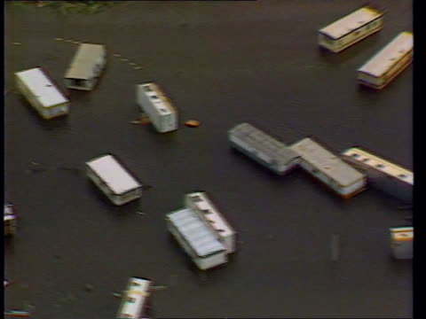 vídeos de stock e filmes b-roll de look back to the hurricane of 1987 lib caravans laying on side in flooded caravan park air view lorry laying on side on bridge lorry laying on side... - 1987