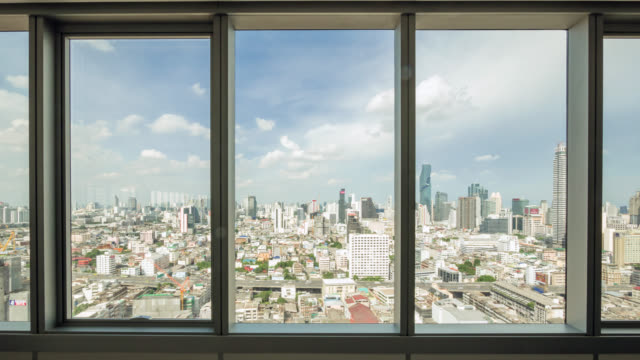look through the city and traffic view in bangkok from office window - tapparella video stock e b–roll