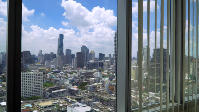 look through the city and traffic view in bangkok from office window - distrust stock videos & royalty-free footage