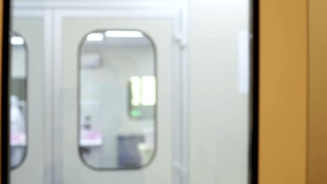 look through the window in medical laboratory - clean room stock videos and b-roll footage