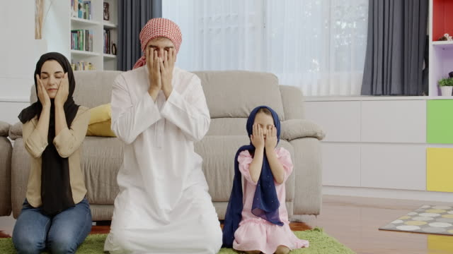look to the right, to the left, hand touch your face to finish pray step. - kneeling stock videos & royalty-free footage