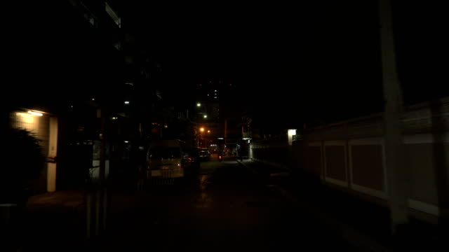 looking a view while ride bike in less light street in bangkok, thailand - low lighting stock videos & royalty-free footage