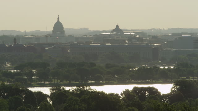 looking across potomac river toward us capitol building in haze, seen from arlington national cemetery. shot in may 2012. - river potomac stock videos & royalty-free footage