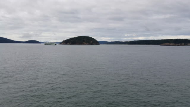 4k looking at a ferry boat cruising through the san juan islands pan to small sailboat - anacortes stock videos & royalty-free footage