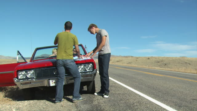 looking at a map on a road trip - see other clips from this shoot 1138 stock videos and b-roll footage