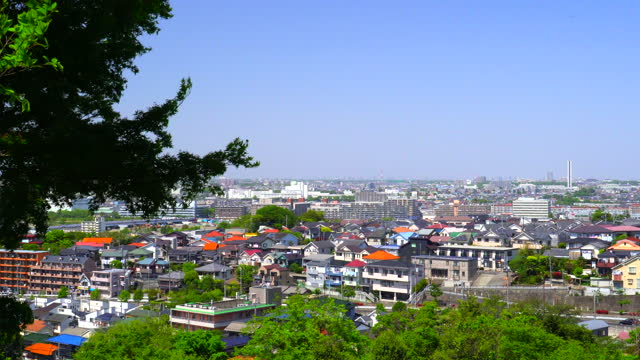 looking at a residential area from a spring park on a hill with beautiful new greenery - plusphoto stock videos & royalty-free footage