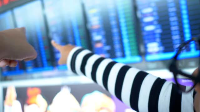 pov : looking at airport departure board - blackboard stock videos & royalty-free footage
