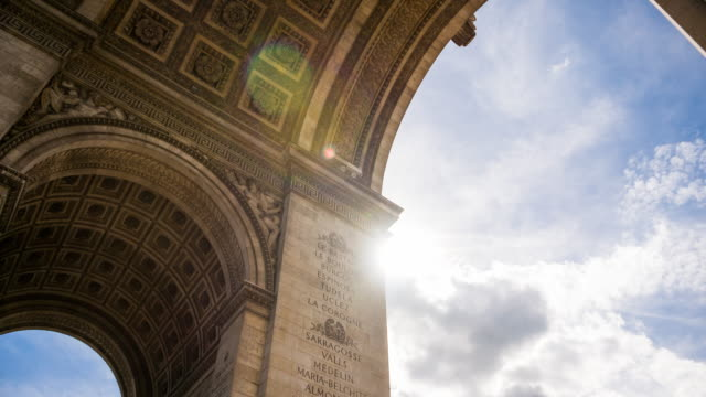 looking at french victories on facade of arch of triumph monument in paris - arc de triomphe paris stock videos & royalty-free footage