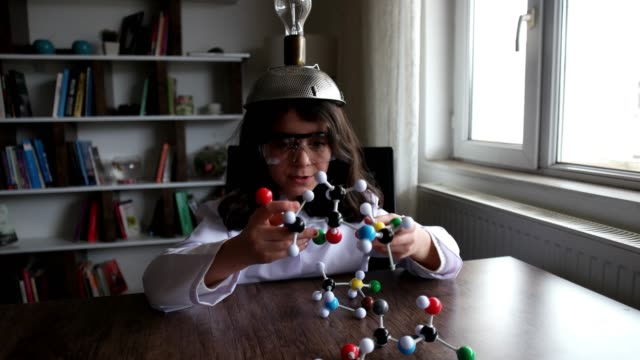 looking at molecular structure model. - building activity stock videos & royalty-free footage
