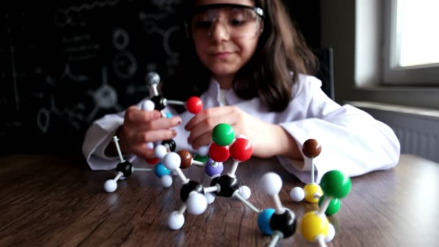 looking at molecular structure model. - model object stock videos & royalty-free footage