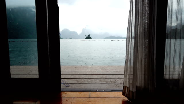 looking at raining view from room floating house - domestic room stock videos & royalty-free footage
