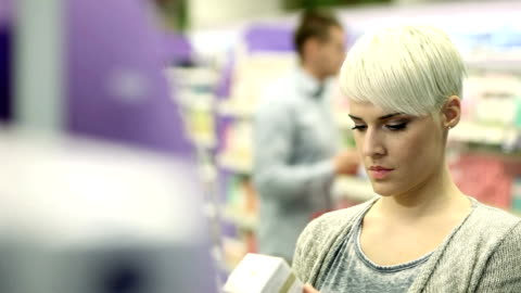 looking at skin care product - market retail space stock videos & royalty-free footage