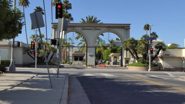 looking at the front gate of paramount studios from across melrose avenue camera zooms out hollywood california - paramount pictures stock videos & royalty-free footage