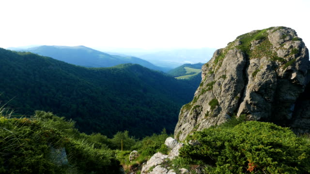Looking at the surrounding landscape from a high point in the mountains.