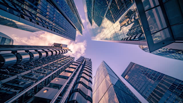 looking directly up at the modern business buildings at financial district in central london - creative stock timelapse - film composite stock videos & royalty-free footage