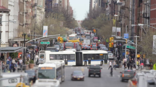 looking down a city street - bus stock videos & royalty-free footage