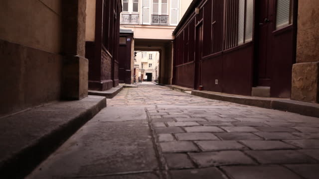 ws looking down a narrow, empty street. - narrow stock videos and b-roll footage