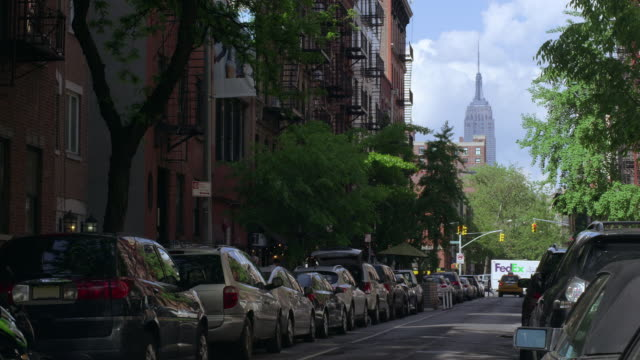 Looking down a NYC street with the Empire State Building in the center